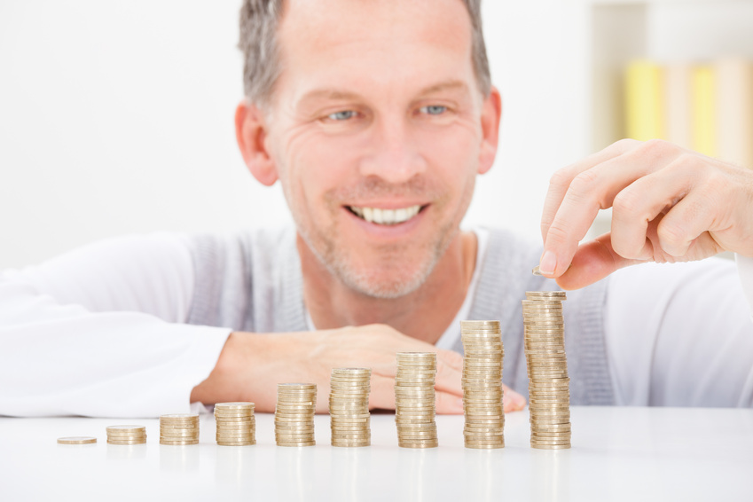 Mature Man Stacking Coins