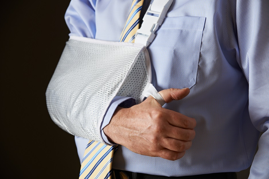 Close Up Of Businessman With Arm In Sling