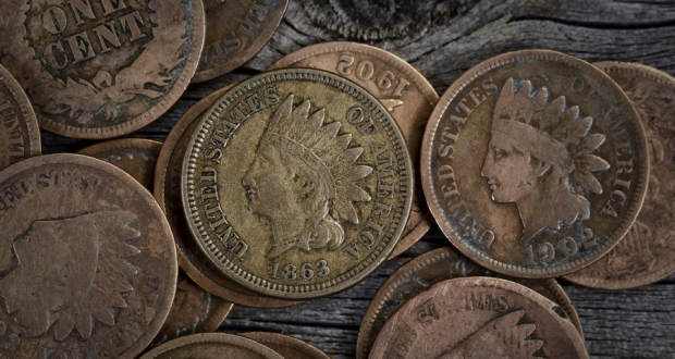 Extreme close up view of One Cent vintage coins on rustic wood